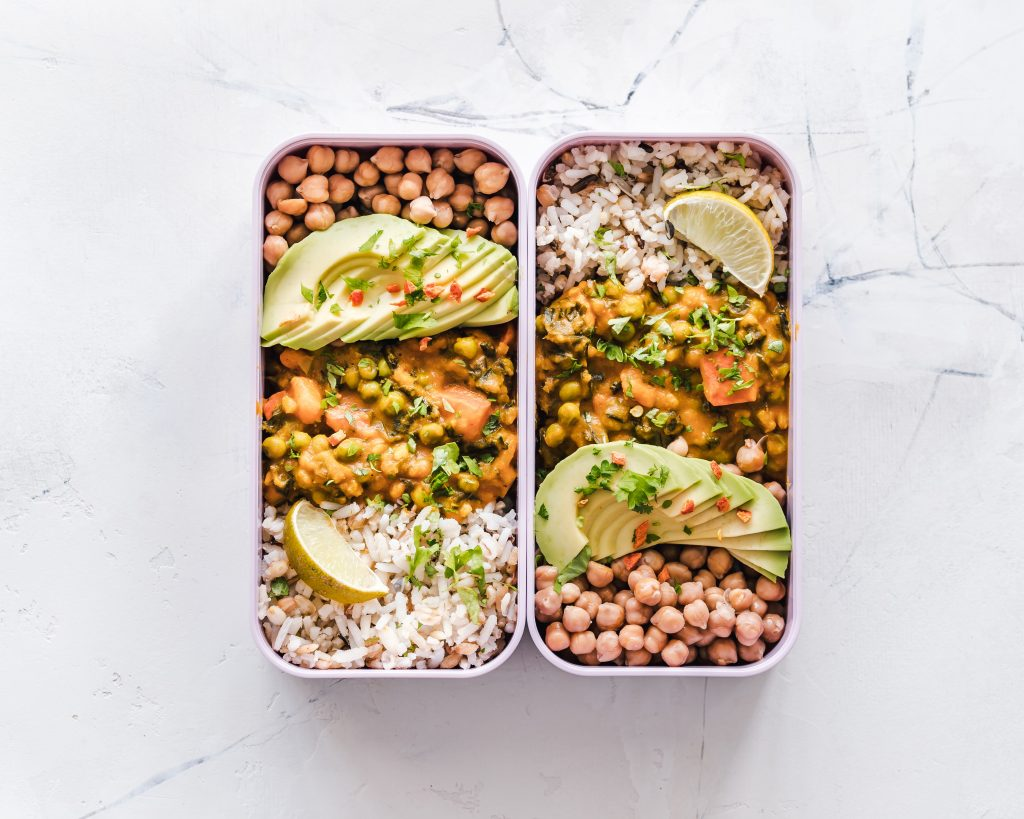 Healthy Meal Prep with curry, avocado, and brown rice